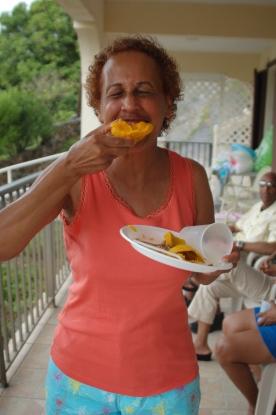 Oma enjoying a mango