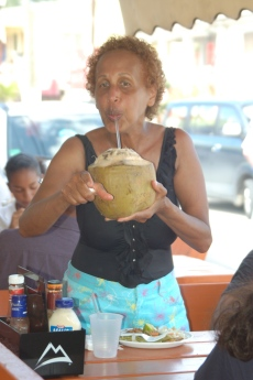 Oma enjoying a fresh coconut.